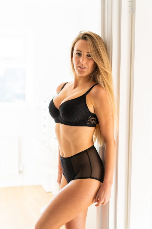 blonde lingerie model in black